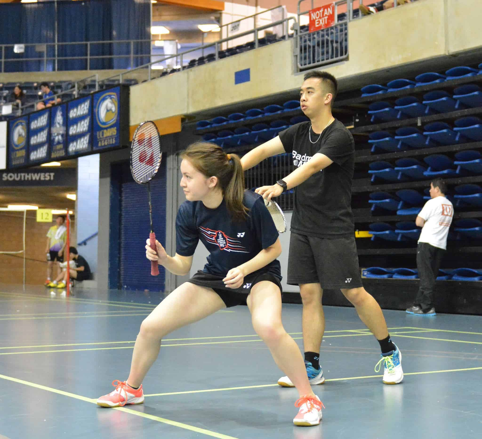 Badminton players playing badminton