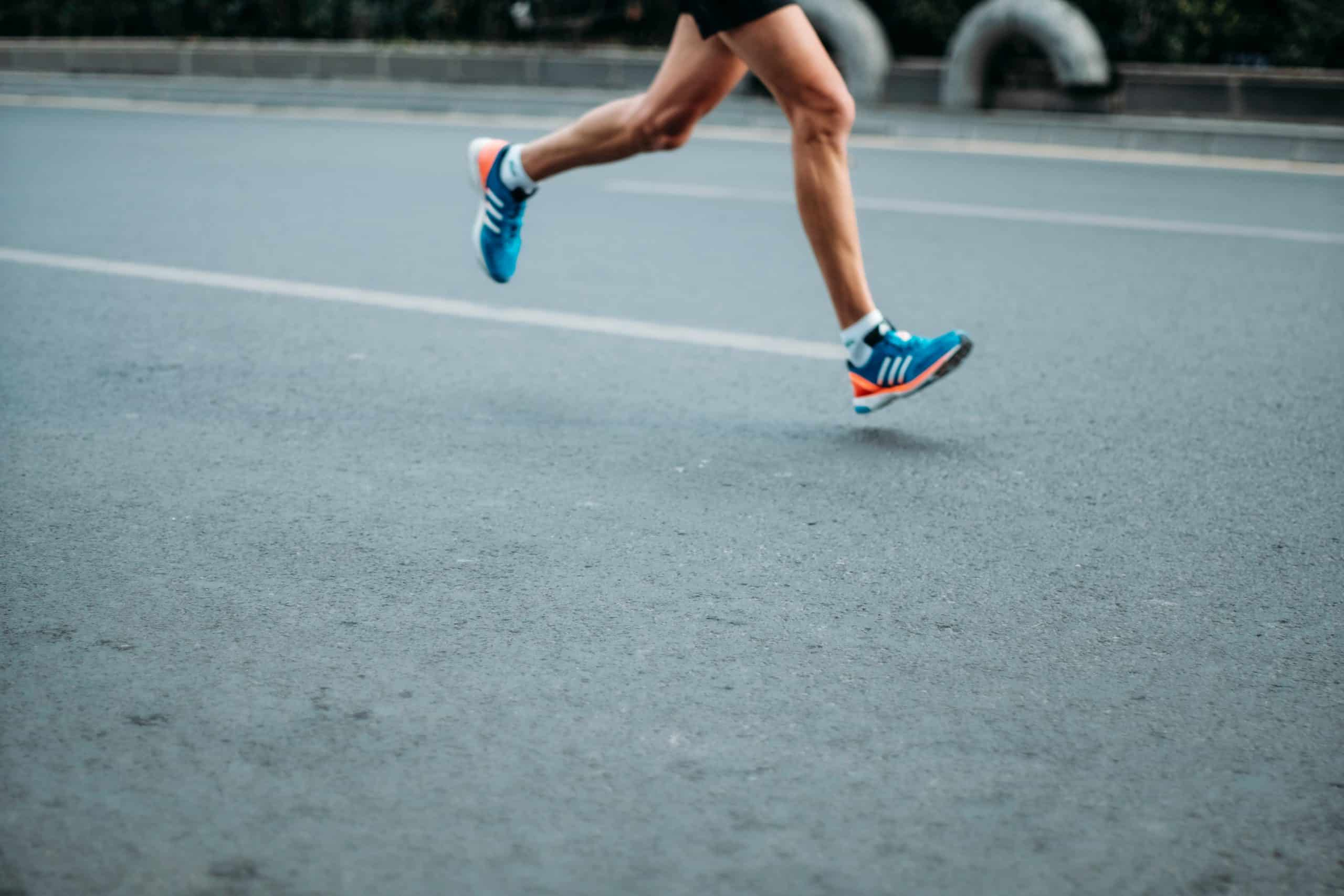 Person running in running shoes