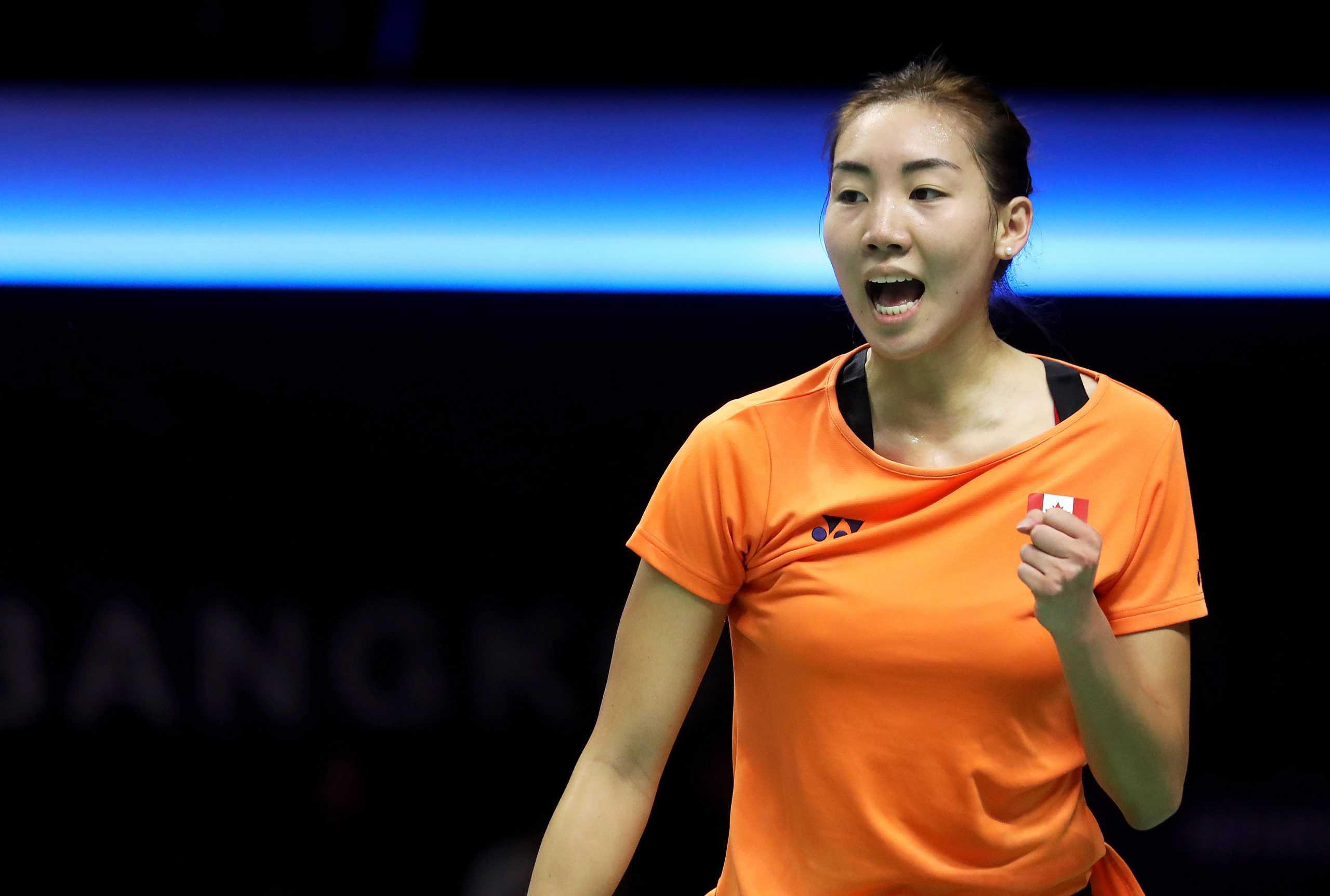 Michelle Li playing badminton